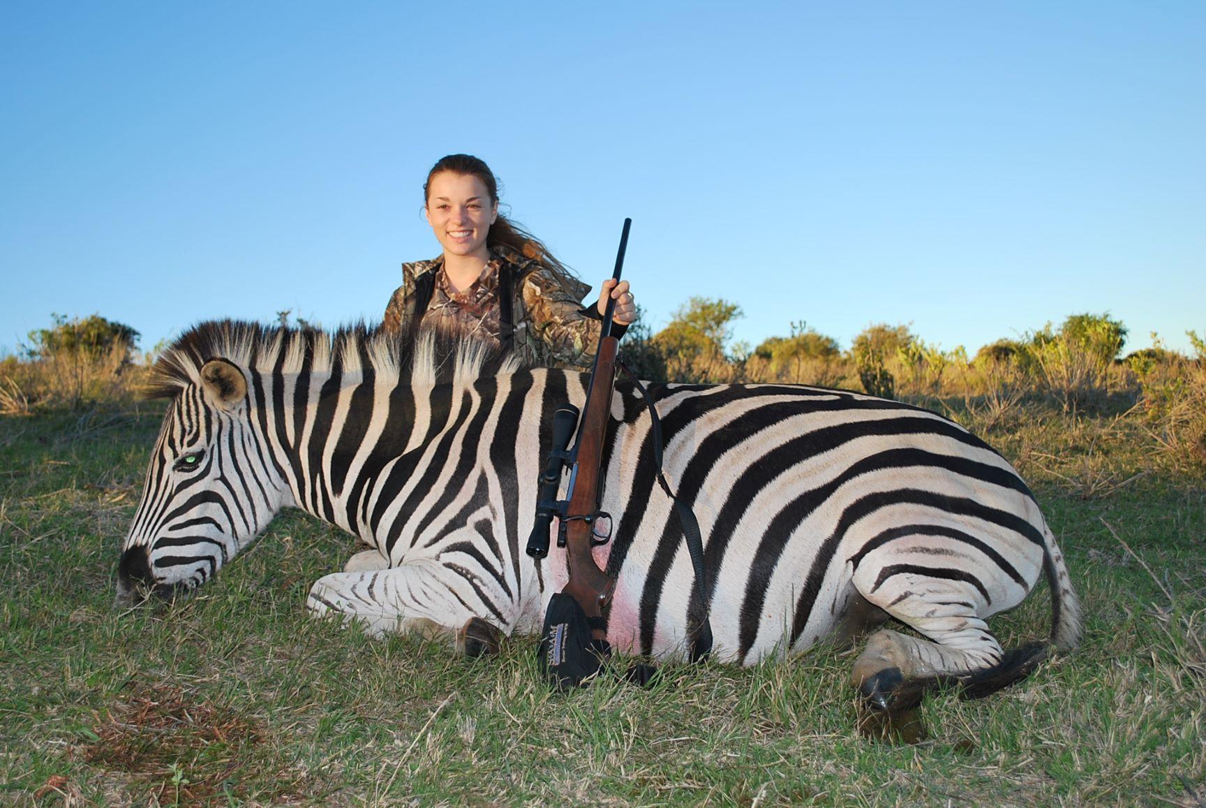 : Caroline Boddington with a big zebra stallion, taken cleanly with a single 140-grain bullet from a CZ 7mm-08.